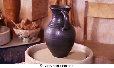 Potters jug rotating on a spinning wheel