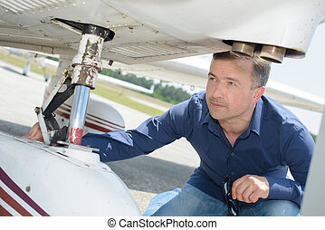 Man checking aircraft