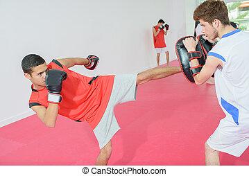 Young man kick boxing