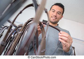 man buying bridle