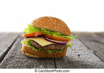 Hamburger cheeseburger on table wooden surface delicious...