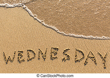 Week series - WEDNESDAY - written on a sandy beach with the...