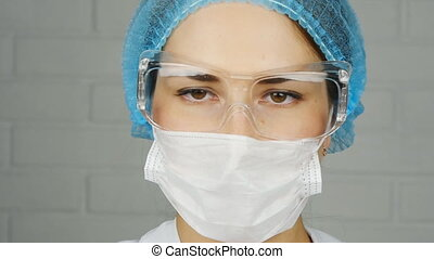 A scientist looks at a sample of a chemical in a laboratory...