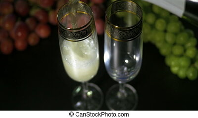Bubbling champagne being poured into two crystal glasses...