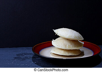 Idli - A platter of a south Indian rice cake or Idli with...