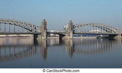 Old Bridge reflected in water - View Bridge Peter Great in...