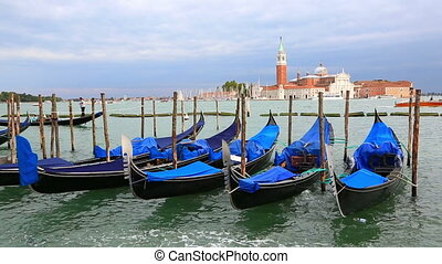 Gondola station and Church of San Giorgio Maggiore, Venice -...