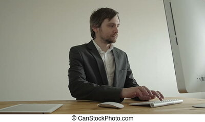 Experienced Businessman Looking at Financial Data with...