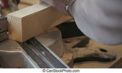 Closeup Carpenter Cutting Plank Wood by Circular Saw