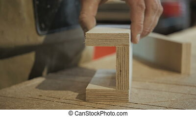 Worker Using Staple Gun to Fix Wood Parts - Worker using...