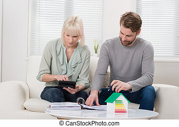 Young Couple Calculating Tax