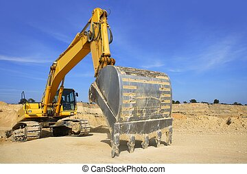 excavator yellow vehicle on sand quarry - excavator yellow...