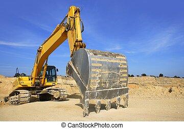 excavator yellow vehicle on sand quarry - excavator yellow...
