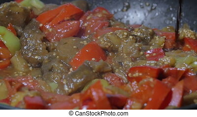 Pouring soy sauce into pan with vegetarian dish - Slow...