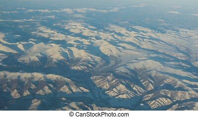Flying over the mountains - View from the airplane on the...