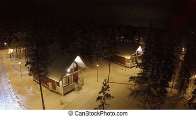 Flying over guest houses in winter holiday village - Aerial...