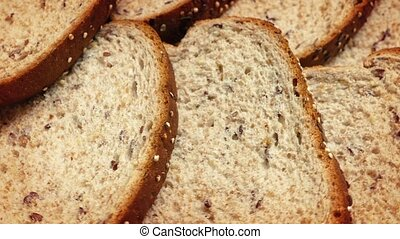 Bread Slices Rotating Closeup - Stack of grainy bread...