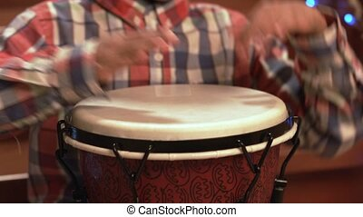 Black kid with drum. Young drum player is scared. I guess it...