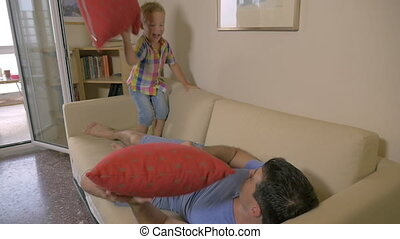 Pillow battle at home - Slow motion of a son and father...