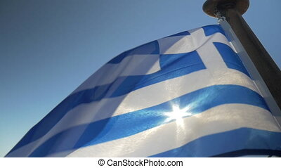 Greek flag waving in the wind on sky background - Slow...