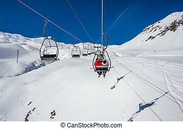 Formigal chairlift in winter resort - Chairlift in winter...