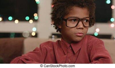 Black kid typing on keyboard - Afro boy using keyboard Black...