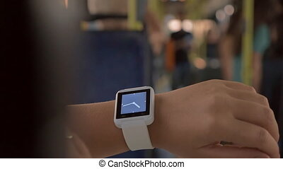 Woman using smartwatch in the bus - Slow motion close-up...