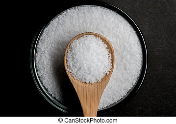 Centered Bowl of Sea Salt with Wooden Spoon Pointing Down