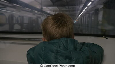 Child traveling in underground - Slow motion of a little boy...