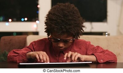 Future programmer Indigo child - Black kid at keyboard Boy...