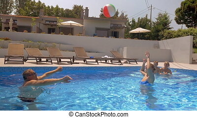 Playing volleyball in the swimming pool - Slow motion of a...