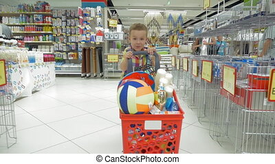 Child going shopping in the supermarket