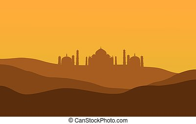 silhouette of Taj Mahal from the desert