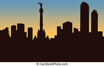 silhouette of mexico city and monument at sunset