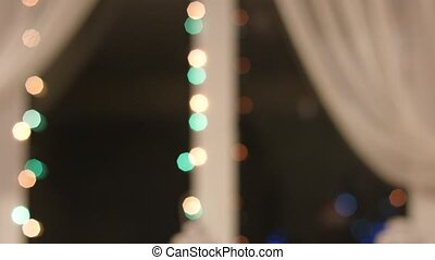 Garland on room window blinking. Christmas garland on white...