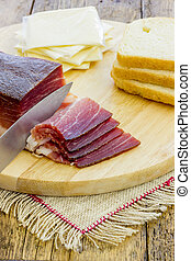 Slices of Italian Speck - Slices of tasty Italian Speck