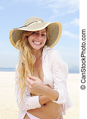 summer fashion: sensual and happy woman on the beach posing