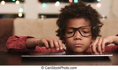 Child at keyboard expressing happiness. - Kid at keyboard...