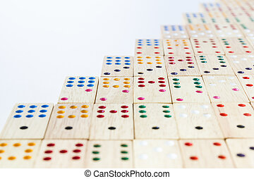 Close up wooden domino tiles on white