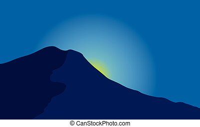 Silhouette of mountain with moon at night