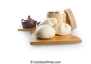 pao or dim sum in bamboo steamer with chinese bun - pao or...
