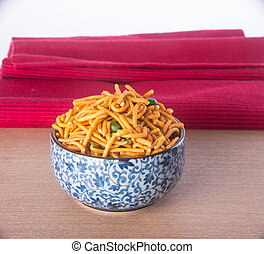 murukku or traditional indian diwali snacks on background -...