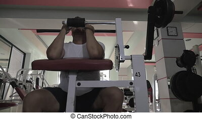Mature man exercising on sportive equipment - Slow motion of...