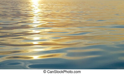Rippling water with sunset reflection - Slow motion of sea...
