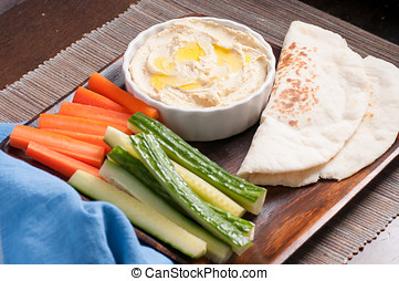 hummus and flatbread and vegetables - vegetable sticks with...