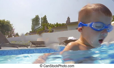 Underwater swimming of a child in goggles