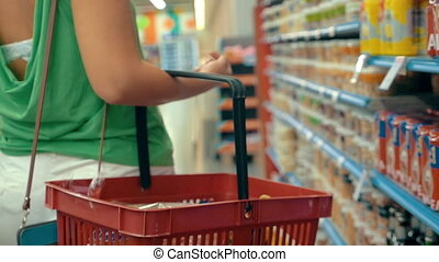 Woman shopping in the grocery store - Slow motion steadicam...