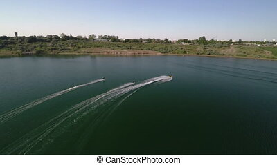 Water Skiing Aerial Shot,Extreme - Jet Ski Riding On The...