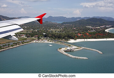 Malaysia. Langkawi - Wing of the plane on a background of...