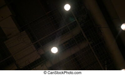 View to the dark ceiling with hanging lamps - Slow motion...